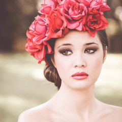 Young beautiful japanese woman with pink and red flowers