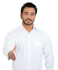 Happy, friendly, successful young business man giving handshake