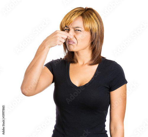 Woman pinches her nose, something stinks, very bad smell