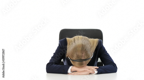 Tired, young beautiful business woman sitting at call center. is