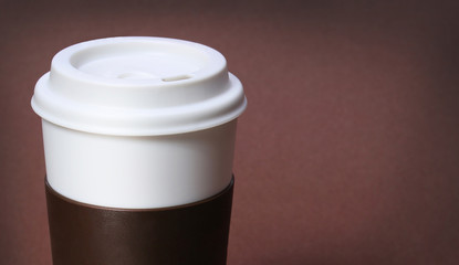 Cup of Coffee on brown background. Takeaway or Disposable Coffee