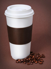 Coffee cup with Coffee Beans on brown background. Takeaway