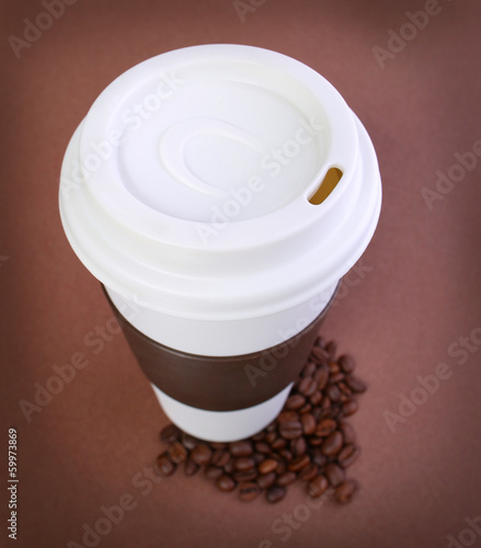 Coffee cup with Coffee Beans on brown. Takeaway