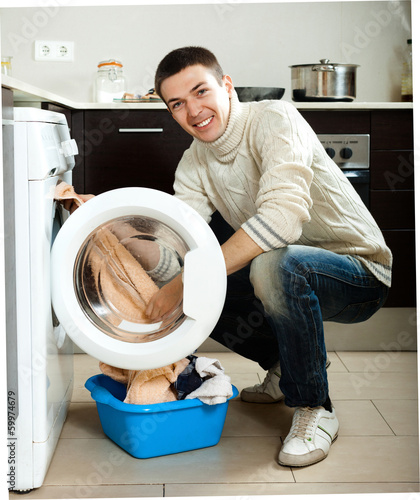 guy using washing machine