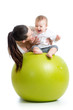 mother playing with baby on fit ball