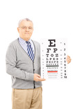 Senior man holding eyesight test
