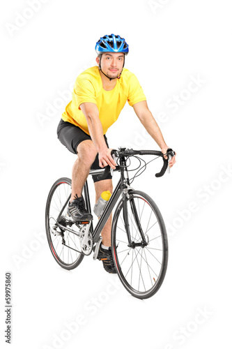Young male biker looking at camera