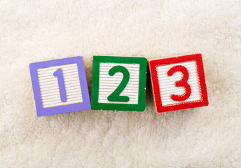 123 toy block with towel background