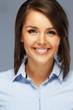Beautiful young brunette woman in blue shirt