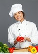 Beautiful young woman cook with fresh tomatoes
