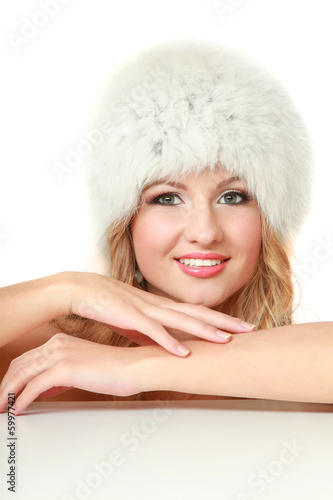 Beauty fashion model girl in a fur hat.