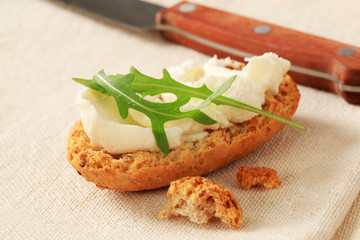 Crisp roll with cheese spread