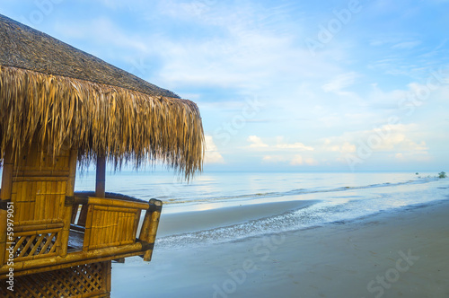 Gazebo with blue skies at sea shore