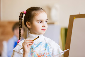 Cute girl painting