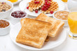 continental breakfast - toast, jam, peanut butter, juice