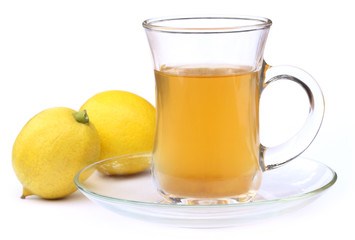 Cup of tea with whole lemon