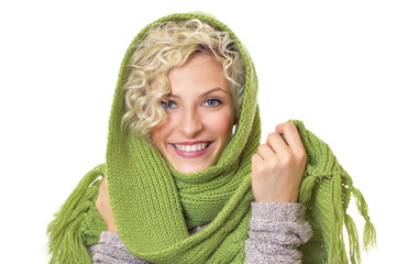 Portrait of a smiling woman wrapped with wool scarf