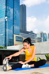 Urban woman sports - fitness in Asian city