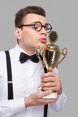 Kissing his trophy.