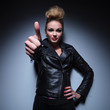 fashion woman making the ok thumbs up hand gesture