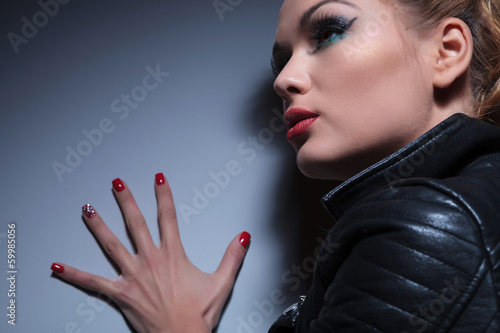 woman with nice make up and red nails manicure, pushing the wal