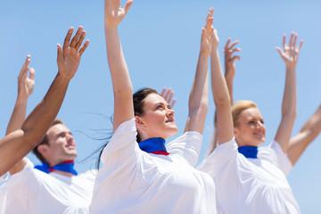 Christian chruch choir praising outdoors