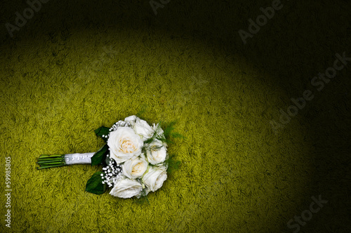 Bridal bouquet on a black couch
