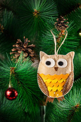 Handmade owl on the tree