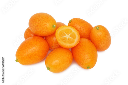 Pile of ripe kumquats (isolated)