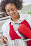 Mixed Race African American Woman Cooking Kitchen