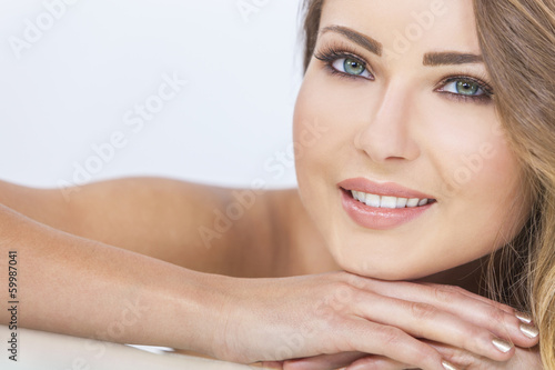 Smiling Beautiful Woman Resting on Hands
