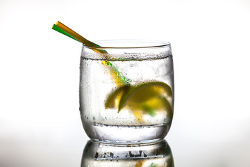 Cocktail with ice and lime slice
