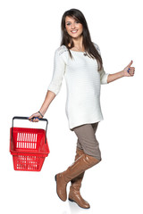 Full length woman walking with red shopping basket