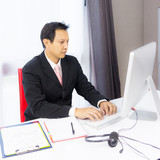business man working with desktop computer