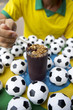 Brazilian Soccer Player Eating Acai with Footballs