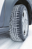 Winter tire in snow, Closeup
