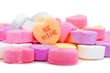 Pile of Valentines Day candies with BE MINE message - 59992847