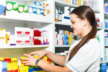 Female pharmacist at the drugstore