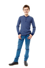 Cheerful teenager with hands in pockets