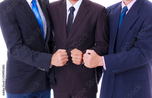 business man team showing fist hand