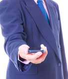 business man holding smart phone isolated