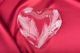 Crystal heart on the vinous silk