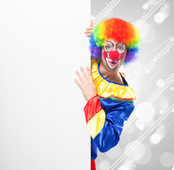 Clown showing a blank board