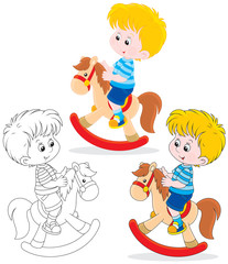 Boy riding on a toy horse