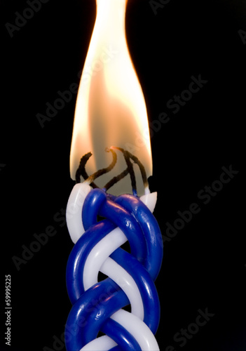 Jewish havdalah candle isolated on black background, vertical