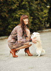 Portrait of beautiful woman with her little dog having good time
