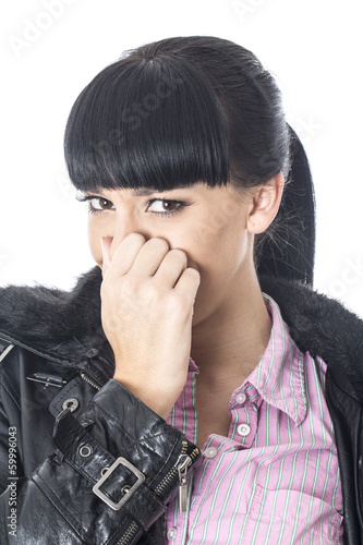 Attractive Young Woman Pinching her Nose
