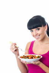 Young Woman Eating Pasta Salad