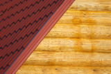 Wooden house wall from logs and part of red roof from tile