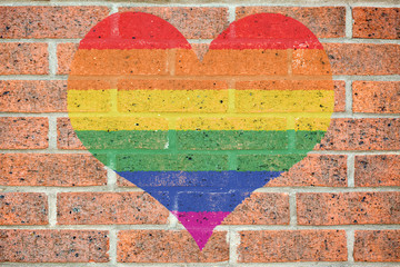 Gay heart on brick wall